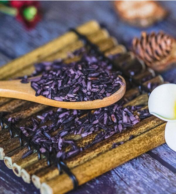 Purple rice on wooden spoon